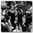 In 1937, the author's grandfather, Generoso, took his wife and children, including Gene,, then ten years old, to Italy for a triumphal return to his birthplace. During a private moment, before Generoso addressed a crowd in Arpaise (center, arm outstretched, top photo), he informed Paolo Capone, longtime mayor of the commune, that he was being replaced in office by Carlo Papa, Generoso's younger brother (bottom left photo).