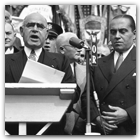 Generoso (r.) was joined here by Judge John J. Freschi (l.) and Governor Herbert Lehman, who is speaking. Note the face of a young, moustachioed Thomas Dewey standing over Generoso's left shoulder.